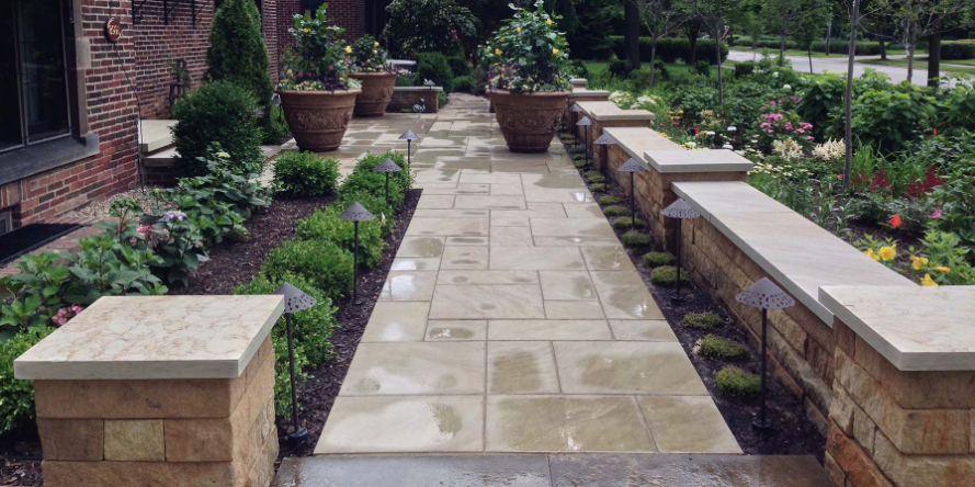 hardscape paver walkway through a garden